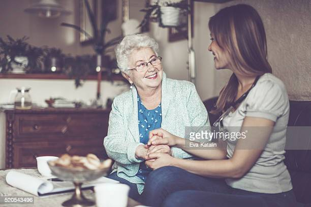 Social worker is visiting a senior woman