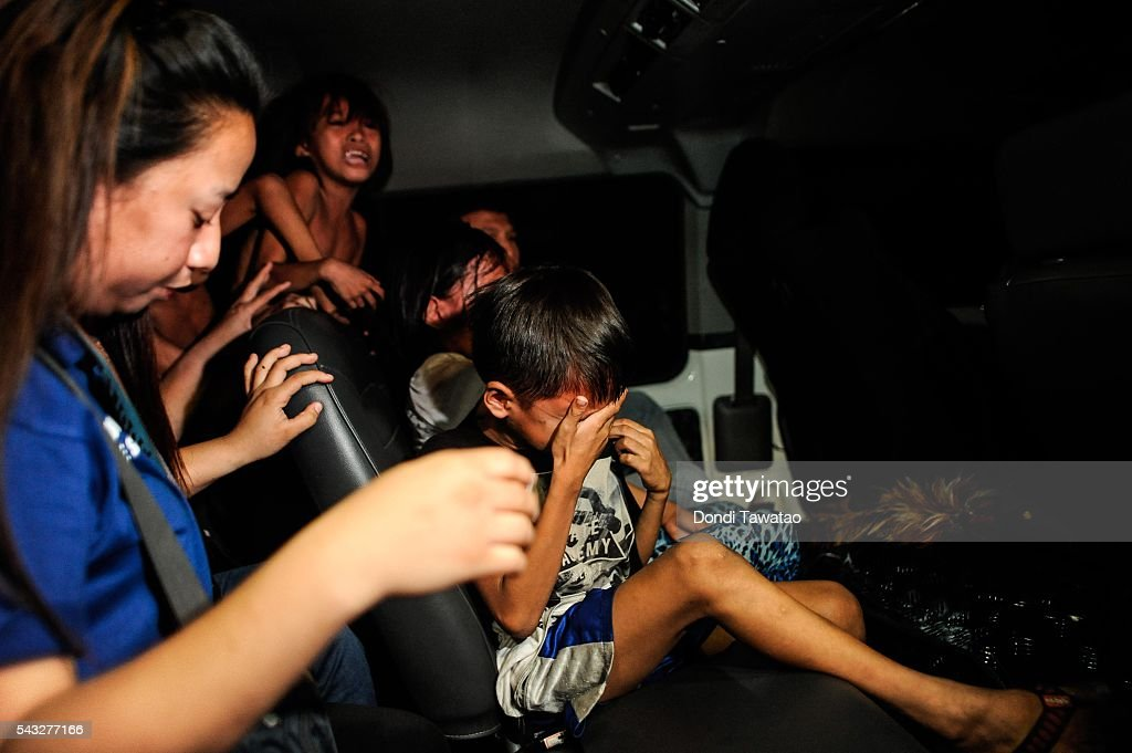 Social workers and police round up minors at night during curfew on June 8 2016 in Manila Philippines The presidentelect of the Philippines Rodrigo...