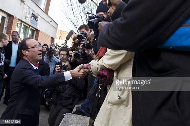 Socialist candidate for the 2012 French presidential election Francois Hollande shakes hands with wellwishers as he arrives to visit a students...