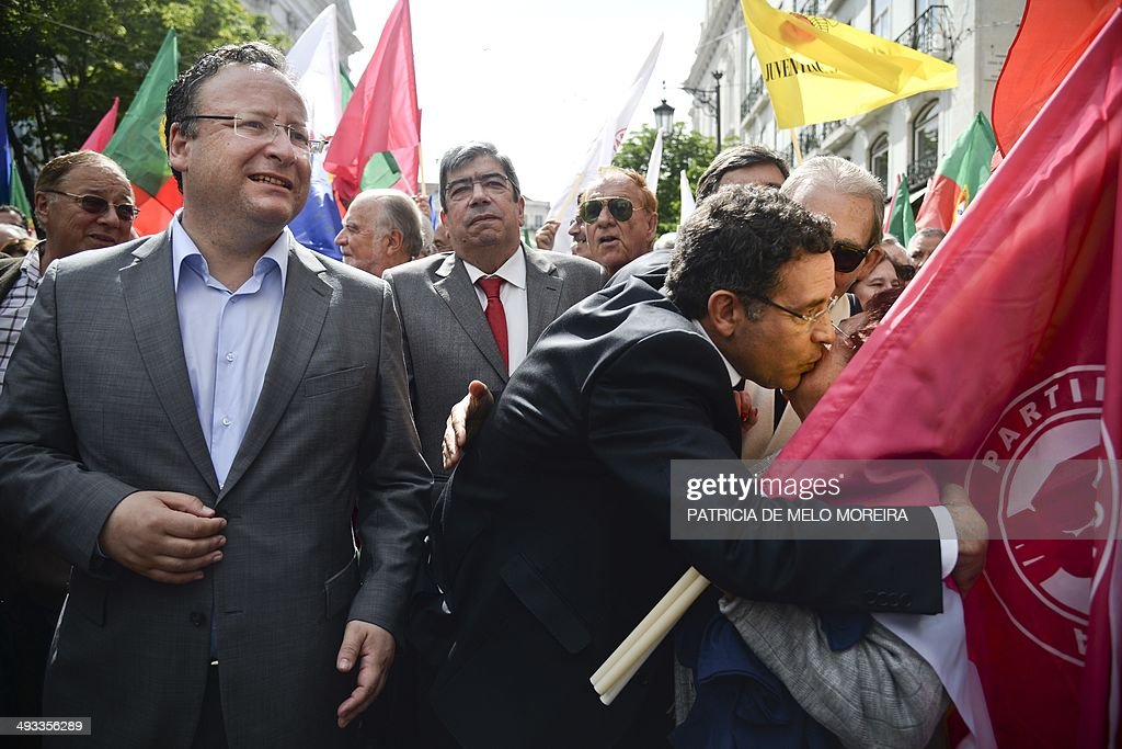 Socialist candidate for the European elections Francisco Assis walks accompanied by the Socialist party leader Antonio Jose Seguro surrounded by...