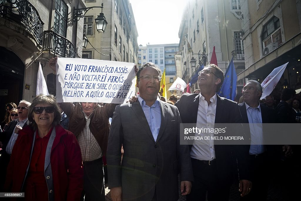 Socialist candidate for the European elections Francisco Assis walks accompanied by the Socialist party leader Antonio Jose Seguro as a supporter...