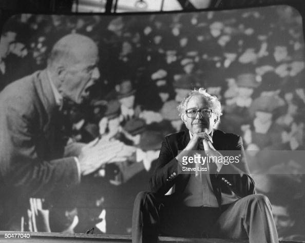 Socialist congressional cand Bernie Sanders posing in front of a pic of socialist labor organizer Eugene V Debs