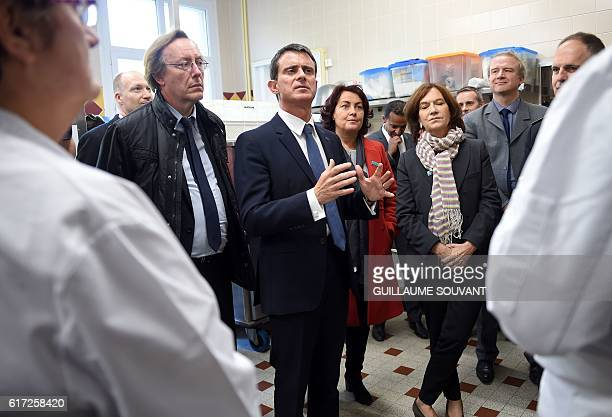 Socialist deputy JeanPatrick Gilles French Prime Minister Manuel Valls and French Minister for Family Children and Women's Rights Laurence Rossignol...
