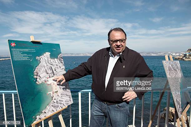 Socialist mayoral candidate in Marseille Patrick Mennucci shows a map of the town during an event from Catalans beach to Corniche district in...
