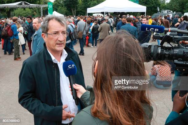 Socialist member of Parliament Francois Lamy speaks to journalists during a rally for the launch of a movement led by French Socialist member Benoit...