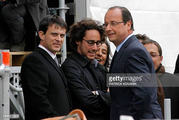 Socialist Party candidate for the 2012 French presidential election Francois Hollande stands near his son Thomas Hollande and his campaign...
