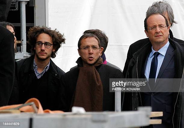 Socialist Party candidate for the 2012 French presidential election Francois Hollande stands near his son Thomas Hollande and his campaign chief of...
