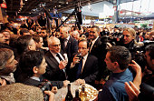 Socialist Party candidate Francois Hollande drinks wine as he visits the Salon De L'Agriculture during his campaign for the 2012 French presidential...