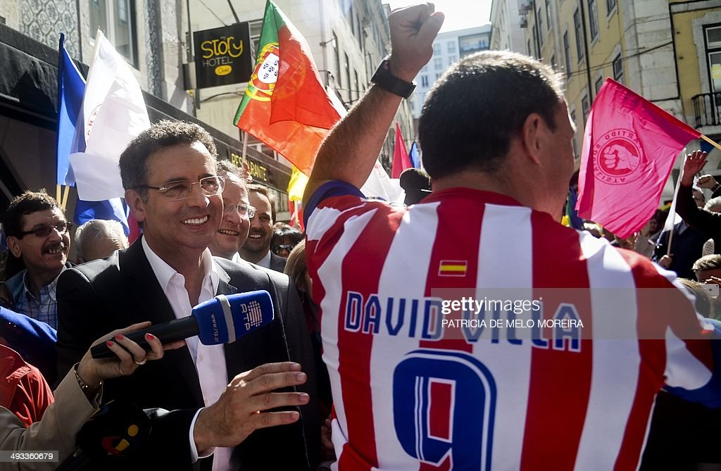 Socialist party leader Antonio Jose Seguro greets Atletico Madrid supporter during a campaign action for the upcoming European Parliament elections...
