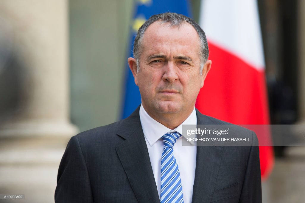 Socialist party parliamentarty group at the French Senate Didier Guillaume stands following a meeting after Britain voted to leave the European Union the day before, on June 25, 2016 at the Elysee presidential Palace in Paris. As the 'Brexit' vote sent global financial markets into freefall, Moody's cut Britain's credit rating outlook to 'negative', saying the vote to pull out of the European Union could hurt its economic prospects. / AFP / GEOFFROY