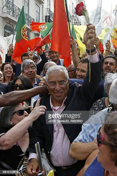 Socialist Party Secretary General Antonio Costa holds a rose as he marches during a political rally for the upcoming October 4 2015 government...
