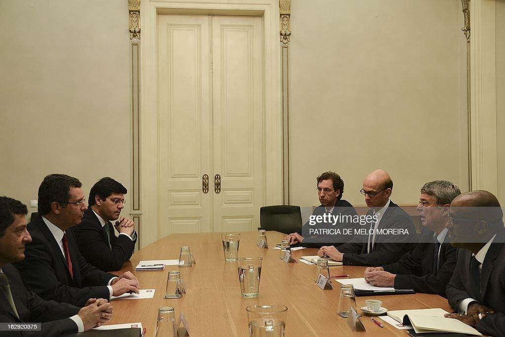Socialist Party Secretary General Antonio Jose Seguro speaks with the head of European Central Bank delegation Rasmus Ruffer head of a European Union...