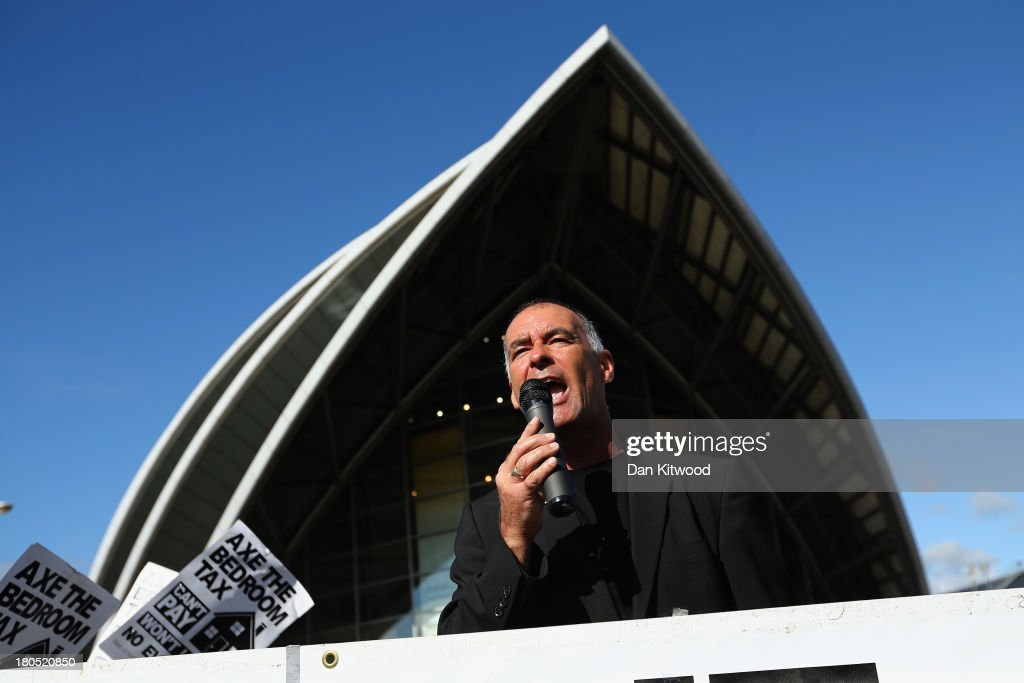 Socialist politician Tommy Sheridan addresses a crowd during a protest outside the Scottish Exhibition and Conference Centre ahead of the Liberal Democrats Autumn conference on September 14, 2013 in Glasgow, Scotland. The Liberal Democrat Autumn conference begins in Glasgow today, with leader Nick Clegg addressing the audience during a rally this evening.