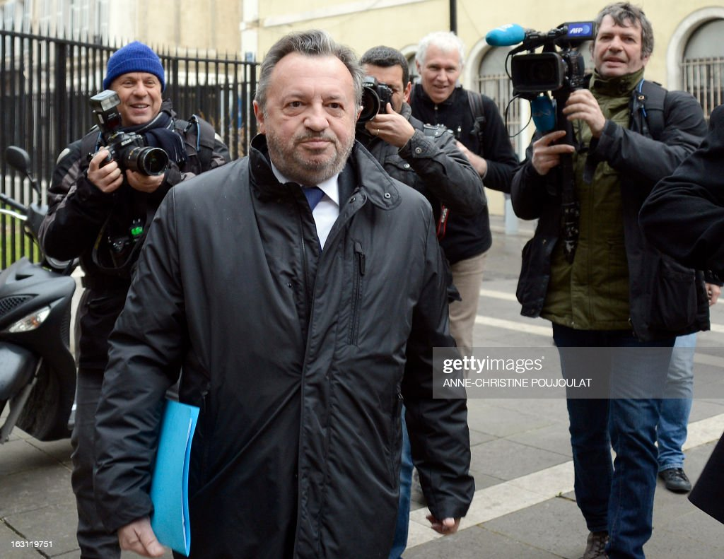 Socialist President of the General Council of the French region Bouches-du-Rhone, Jean-Noel Guerini (C) arrives on March 5, 2013 to Marseille's courthouse, prior to a hearing as part of investigations in a case of alleged unfair dismissal of a former member of Guerini's office. Jean-David Ciot, former member of Guerini's office at the General Council, was elected member of the Parliament in 2012 and is current First Secretary of the Socialist Party (PS) federation of the Bouches-du-Rhone. AFP PHOTO / ANNE-CHRISTINE POUJOULAT