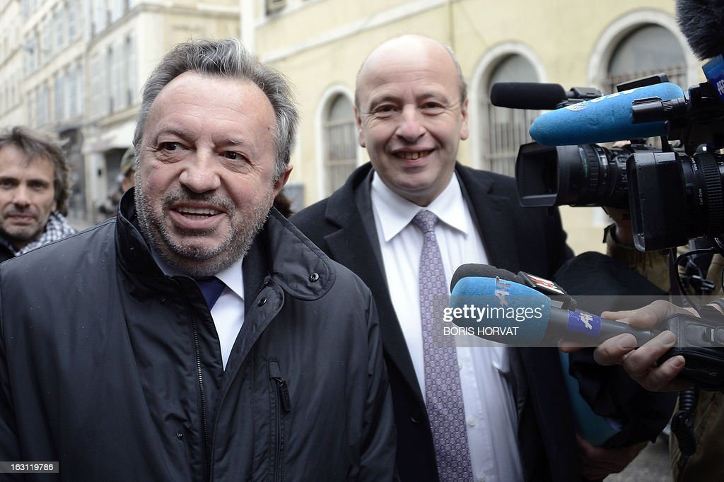 Socialist President of the General Council of the French region Bouches-du-Rhone, Jean-Noel Guerini (L) arrives with his lawyer Dominique Mattei (C) on March 5, 2013 to Marseille's courthouse, prior to a hearing as part of investigations in a case of alleged unfair dismissal of a former member of Guerini's office. Jean-David Ciot, former member of Guerini's office at the General Council, was elected member of the Parliament in 2012 and is current First Secretary of the Socialist Party (PS) federation of the Bouches-du-Rhone.