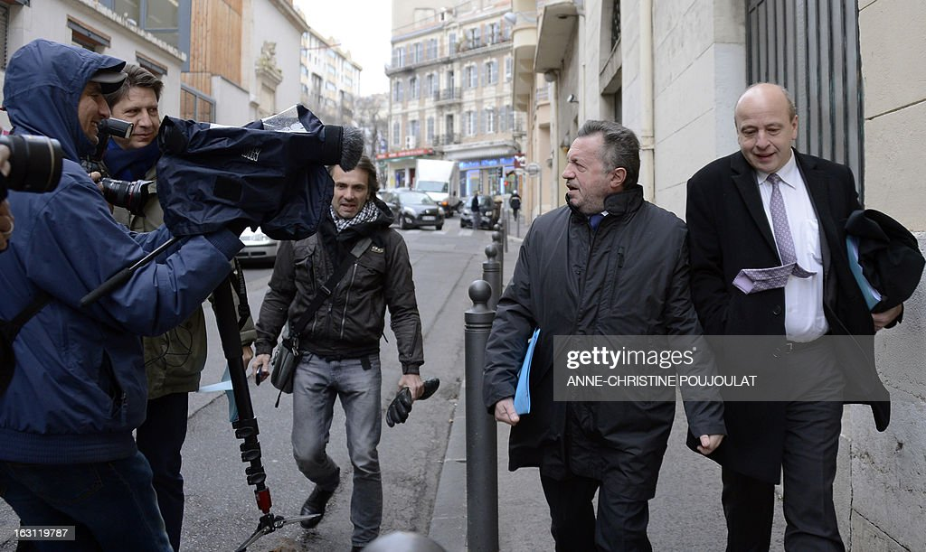 Socialist President of the General Council of the French region Bouches-du-Rhone, Jean-Noel Guerini (2ndR) looks at reporters as he arrives with his lawyer Dominique Mattei (R) on March 5, 2013 to Marseille's courthouse, prior to a hearing as part of investigations in a case of alleged unfair dismissal of a former member of Guerini's office. Jean-David Ciot, former member of Guerini's office at the General Council, was elected member of the Parliament in 2012 and is current First Secretary of the Socialist Party (PS) federation of the Bouches-du-Rhone.