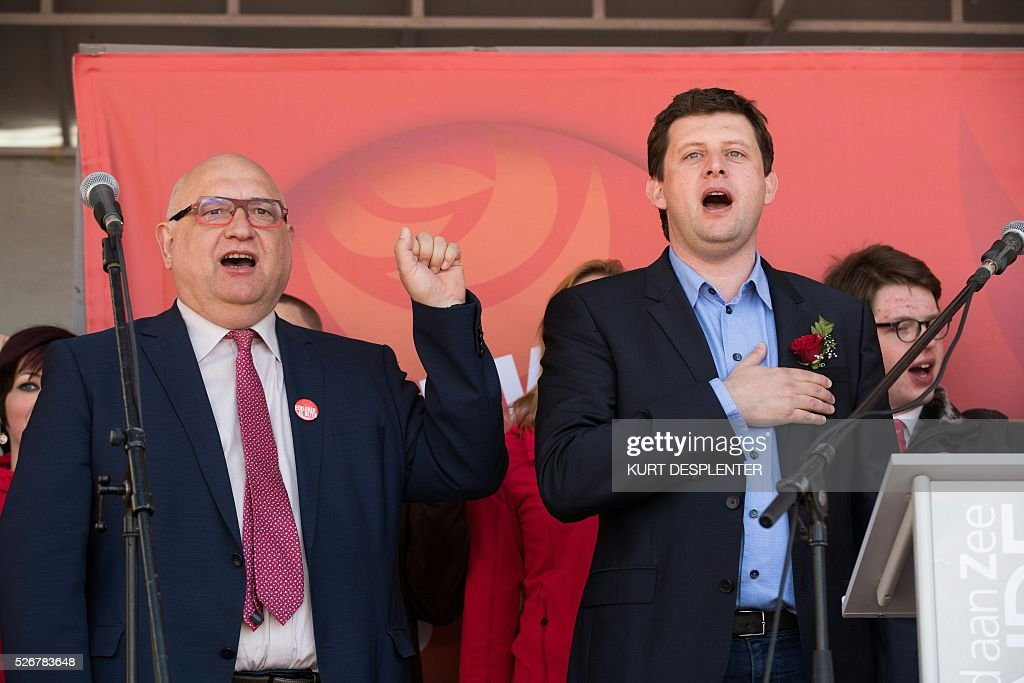 FGTB socialist union chairman Rudy De Leeuw (L) and Sp.a chairman John Crombez attend a May Day meeting of the sp.a Flemish socialists, in Oostende, on May 1, 2016. / AFP / Belga / KURT DESPLENTER / Belgium OUT