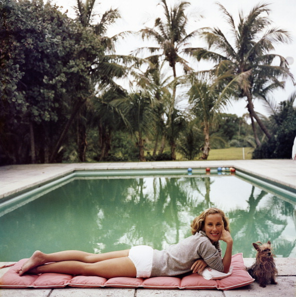 Socialite Alice Topping relaxing at a poolside in Palm Beach A Wonderful Time Slim Aarons