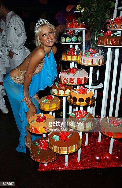 Socialite and hotel heiress Paris Hilton smiles after blowing out candles at her 21st birthday party at Studio 54 February 13 2002 in New York City
