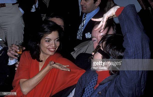 Socialite Bianca Jagger producer Jack Haley Jr and actress/singer Liza Minnelli attend Studio 54's New Year's Eve Party on December 31 1977 at Studio...