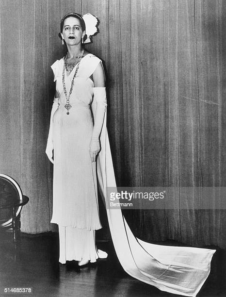 Socialite Diana Vreeland wears a gown for her presentation to the court in Buckingham Palace