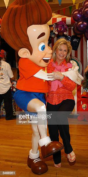 Socialite Kathy Hilton poses with Jimmy Neutron at the Childrens Day Artrageous Carnival Benefiting Foster Children April 25 2004 in New York City
