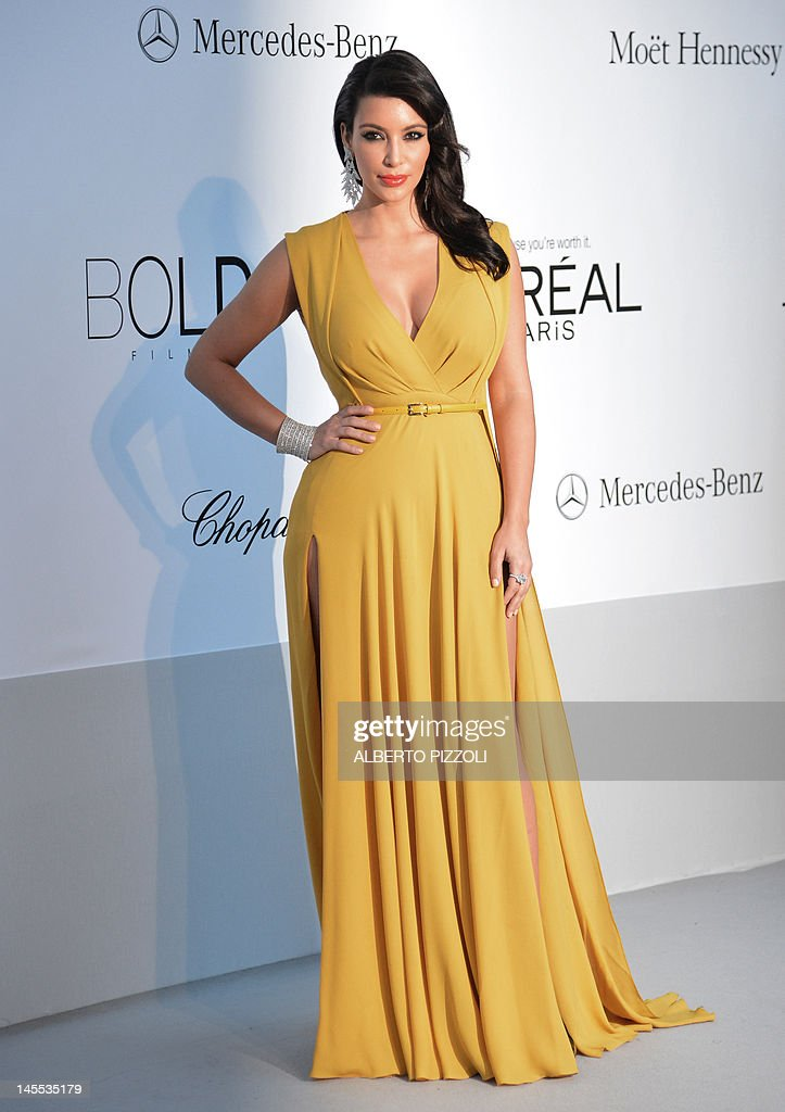 US socialite Kim Kardashian poses as she arrives to attend the 2012 amfAR's Cinema Against Aids on May 24, 2012 in Antibes, southeastern France.