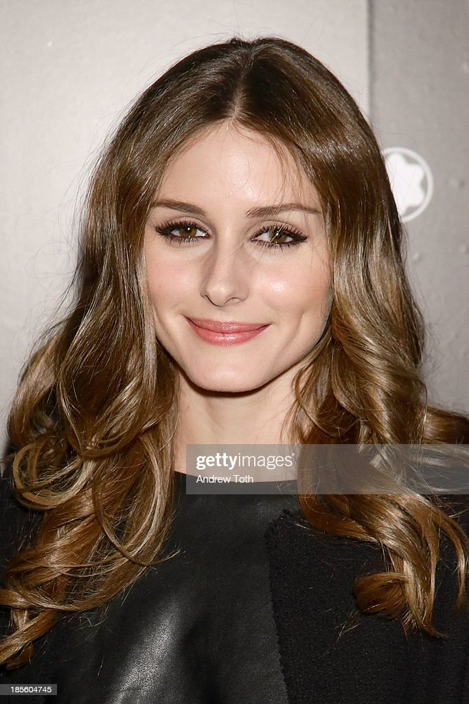 Socialite <a gi-track='captionPersonalityLinkClicked' href=/galleries/search?phrase=Olivia+Palermo&family=editorial&specificpeople=2639086 ng-click='$event.stopPropagation()'>Olivia Palermo</a> attends the Montblanc Madison Avenue store opening on October 22, 2013 in New York City.