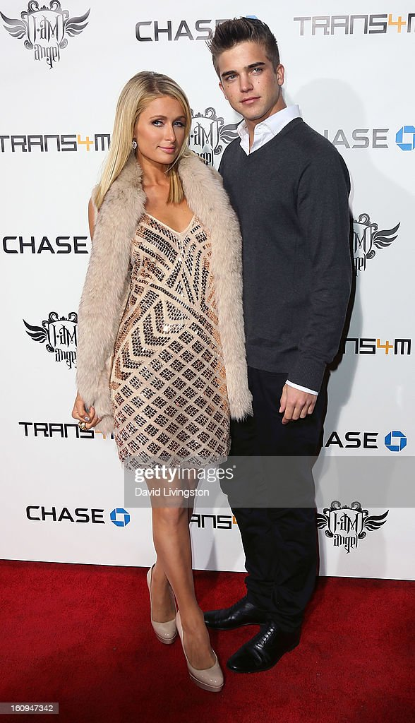 Socialite Paris Hilton (L) and boyfriend model River Viiperi attend the 2nd Annual will.i.am TRANS4M Boyle Heights benefit concert at Avalon on February 7, 2013 in Hollywood, California.