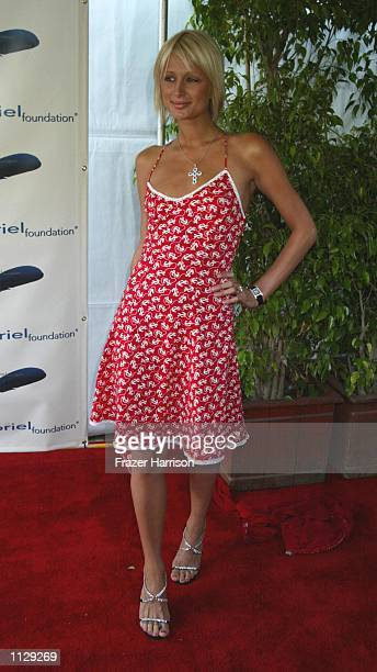Socialite Paris Hilton attends the Parrots in Paradise benefit at the Playboy Mansion June 27 2002 in Beverly Hills California The benefit honored...