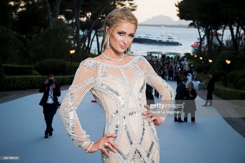 Socialite Paris Hilton poses for photographs at the amfAR's 23rd Cinema Against AIDS Gala at Hotel du Cap-Eden-Roc on May 19, 2016 in Cap d'Antibes, France.