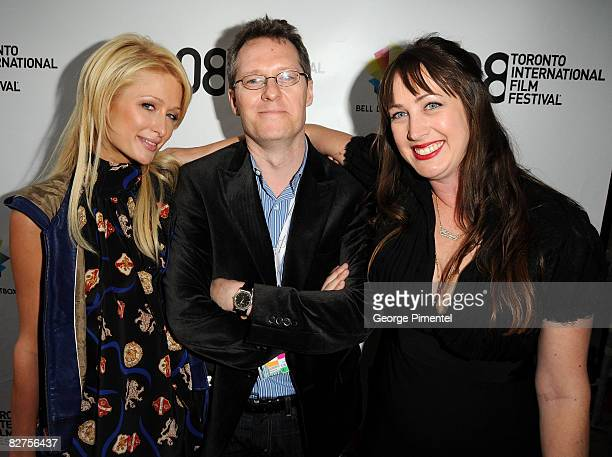 Socialite Paris Hilton TIFF programmer Thom Powers and director Adria Petty arrive at the 'Paris Not France' film premiere held at Reyerson Theatre...