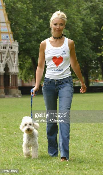 Socialite Tamara Beckwith and her dog Balthazar pose for photographers during the launch of the new 'Love to Lead' campaign in association with...