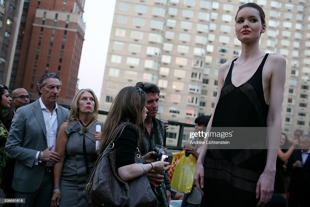 Socialites attend a fashion presentation at the rooftop bar of the Empire Hotel in Lincoln Center Despite a deep recession across America and...