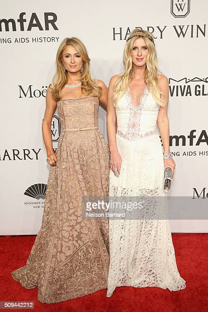 Socialites Paris Hilton and Nicky Hilton attend the 2016 amfAR New York Gala at Cipriani Wall Street on February 10 2016 in New York City
