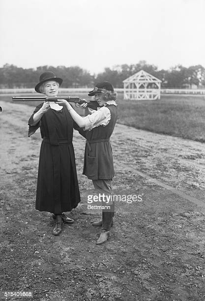Society Circus rehearsalPhoto shows Miss Annie Oakley teaching Dorothy Stone daughter of Mr and Mrs Fred Stone how to shoot