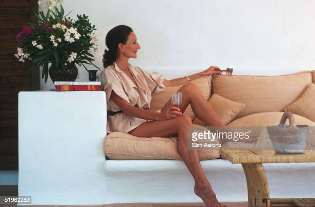 Society hostess and fashion designer Viscountess Jacqueline de Ribes relaxes on the terrace of her house in Ibiza Spain September 1978