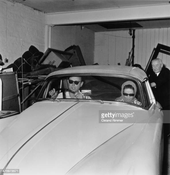 Society osteopath Stephen Ward at the wheel of his Jaguar XK150 drophead coupe as he and a female passenger leave his flat at Bryanston Mews London...