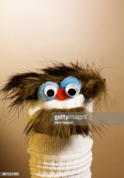 Sock Puppet with Moustache with Concerned Expression