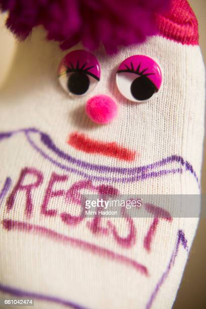 Sock Puppet with Pink Hair with the word RESIST on Shirt
