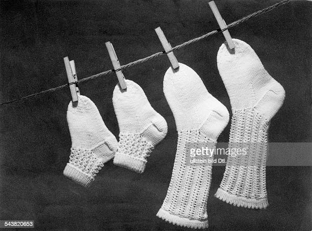 Socks and ankle socks hanging on a clothesline Picture by Rolf Lutz 1953