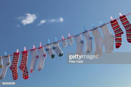 socks hanging on washing line : Stock Photo