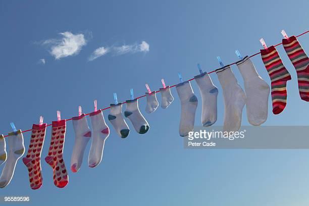 socks hanging on washing line
