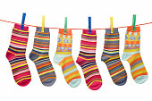 Children socks caught with forceps.isolated on white background