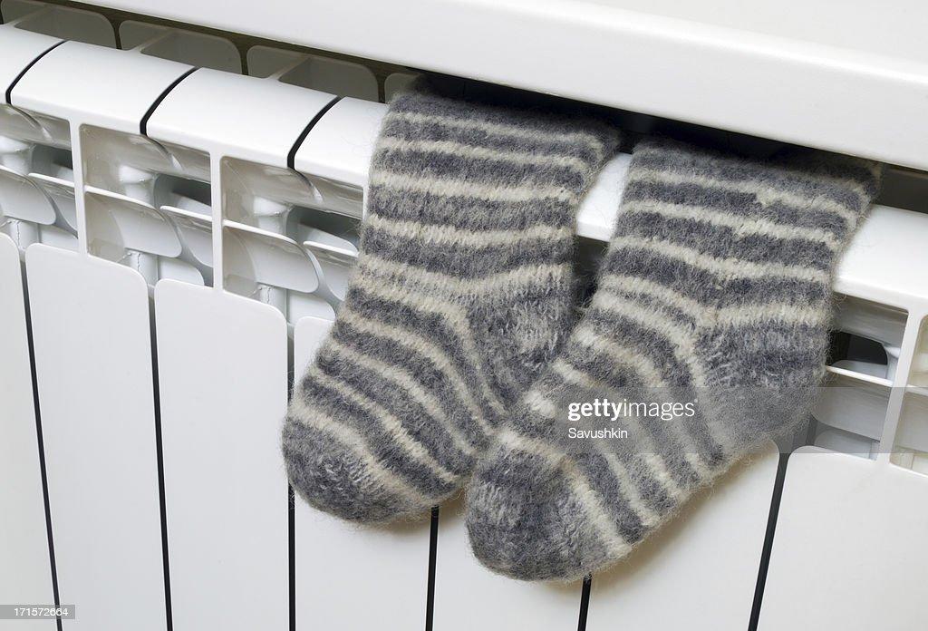 Socks on the radiator : Stock Photo
