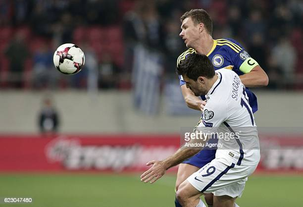 Socratis Papastathopoulos of Greece in action against Edin Dzeko of Bosnia and Herzegovina during the 2018 World Cup qualifying Group H football...