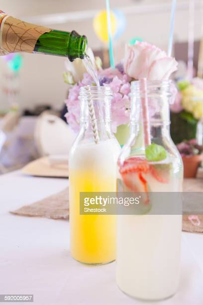 Soda and cocktails on party table