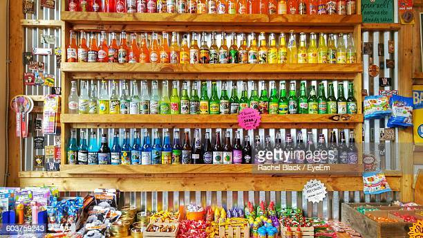 Soda Bottles And Candies For Sale At Shop