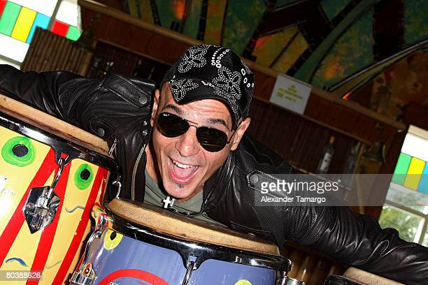 Soda Stereo bassist Zeta Bosio poses during a press conference at Bongos Cuban Cafe March 26 2008 in Miami Florida
