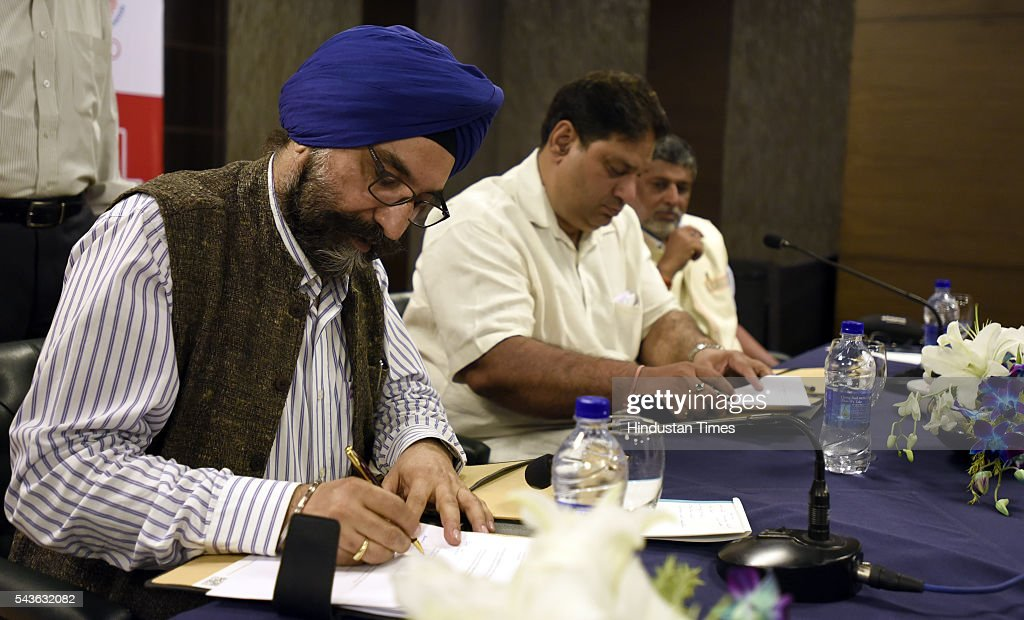 RS Sodhi Managing Director Gujarat Cooperative Milk marketing federation ( Amul) and Rajeev Mehta Secretary General Indian Olympic Association ( IOA) MOU singing the official Sponsorship of AMUL, the Indian contingent for the Rio 2016 Olympic, on June 29, 2016 in New Delhi, India.